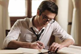 man writing books